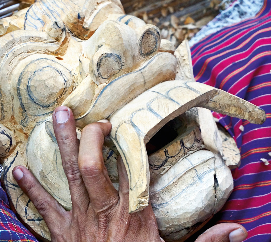 An artisan in Gianyar Regency's carving district, Bali
