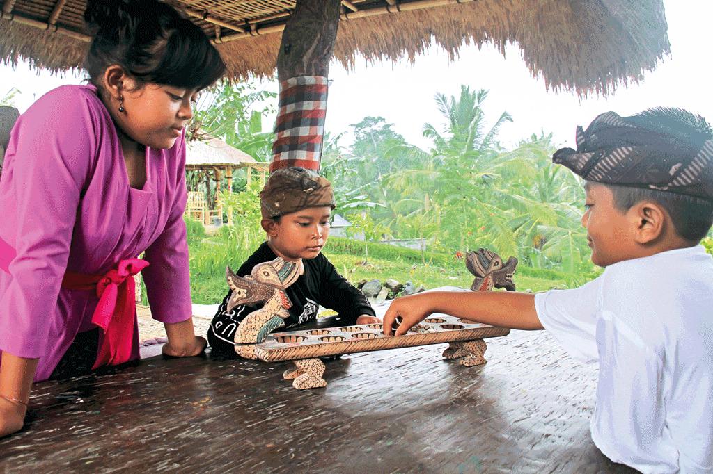 Playing-a-round-of-Congklak-game-at-Desa-Visesa-Ubud
